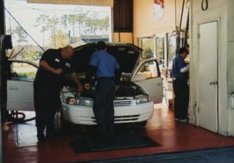 An oil change in progress in 1996