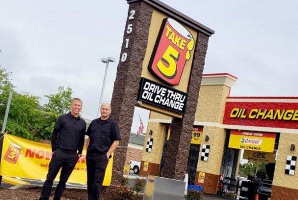 Take 5 franchise owners standing outside their Take 5 location.